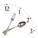 Klok die van lepel en vork wordt gemaakt stock fotografie