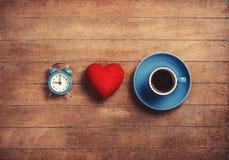 Klok, hart en kop Stock Afbeeldingen