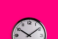 Klok op roze Royalty-vrije Stock Foto's