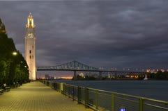 Klokketoren en Jacques Cartier Bridge Stock Afbeeldingen