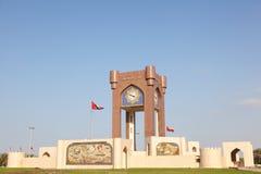 Klokketorenrotonde in Muscateldruif, Oman stock fotografie