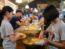 Klong Lat Mayom Floating Market, the old market in Thailand have a lot of eating food and dessert. Royalty Free Stock Photo