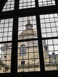 Klostertorn för El Escorial till och med ett fönster Fotografering för Bildbyråer