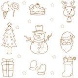 Klotter av attraktion för juluppsättninghand Arkivbild