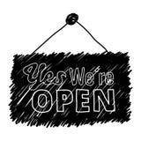 Klotter av ordet 'ja är vi öppna', Fotografering för Bildbyråer