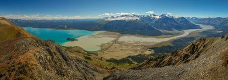 Kluane lake in Kluane National park reserve in Yukon territory, Canada. Panoramatic view of beatiful blue Kluane lake in Kluane National park reserve in Yukon stock photo