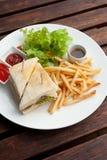 Klubbasmörgås med fransmansmåfiskar på sida arkivfoto