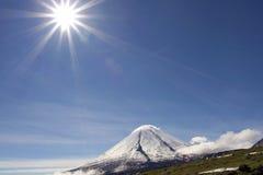 Kluchevskoy volcano and sun Stock Image