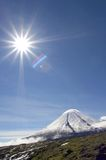 Kluchevskoy volcano and sun Royalty Free Stock Photography