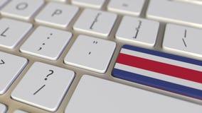 Klucz z flag? Costa Rica na komputerowej klawiatury zmianach wpisywa? z flag? usa, przek?ad lub przeniesienie, zbiory wideo