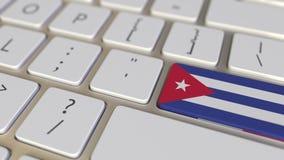 Klucz z flagą Kuba na komputerowej klawiatury zmianach wpisywać z flagą Francja, przekład lub przeniesienie, odnosić sie ilustracji