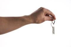 Klucze w ręce odizolowywającej na bielu Zdjęcia Royalty Free