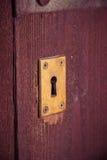 Kluczowa dziura w starym drewnianym drzwi Zdjęcie Stock