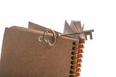Kluczowy i ślimakowaty notatnik Fotografia Stock