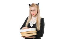 Kluges blondes Mädchen mit Gläsern und Stapel von Büchern Stockfotografie