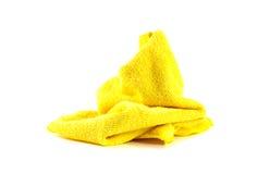 Klumpa sig den gula handduken Arkivfoto