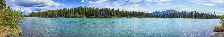 Klutina River - Alaska. The Klutina River, famous for its King Salmon, runs its course through the beautiful mountain scenery of Alaska. On its way down from the stock photography