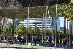 Klyde Warren Park in Dallas, Texas. Yoga session at Klyde Warren Park in Dallas, Texas. The urban park is open to the public, but is operated by the private Stock Image