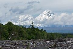 Klyuchevskoy and Kamen Volcano on a cloudy day. Kamchatka Stock Photo