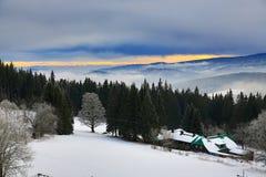 220 km distant peaks of the Alp, Cloudes and trees, winter landscape in Šumava in Železná Ruda, Czech republic Stock Photos