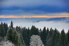 220 km distant peaks of the Alp, Cloudes and trees, winter landscape in Šumava in Železná Ruda, Czech republic Royalty Free Stock Image