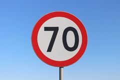 70 km/h speed limit road sign with a blue sky background. 70 km/h speed limit - Polish road sign with a blue sky background stock photo