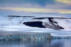 Franz Josef Land - glaciers. 900 km from North Pole. Franz Josef Land - glaciers in Strait of Booth and American Strait. Front wall of glacier, ice barrier stock photos