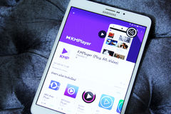 KMPlayer app. Downloading KMPlayer application from google play store on samsung tablet Stock Photo