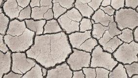 Knäckt textur för jord torka arkivfoto