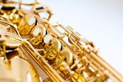 Knäppas saxofonen Arkivbild