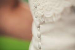 Knöpfe auf dem Kleid Lizenzfreie Stockbilder