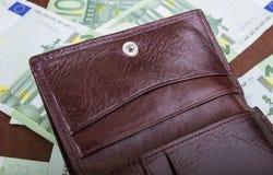 Knöpfen Sie auf einer Mann ` s Geldbeutelnahaufnahme Lizenzfreie Stockfotos