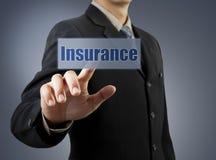 Knapp för försäkring för affärsmanhand driftig Arkivbild