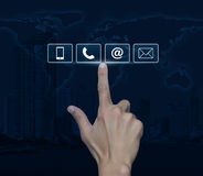 Knappar för telefon, för mobiltelefon, på och för email för trycka på för hand över Arkivbild