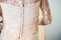Knappar på klänningen Arkivbild
