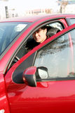 Knappe Aziatische mens in de auto Stock Foto