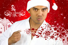 Knappe Aziatische mens met een Kerstmanhoed Stock Fotografie