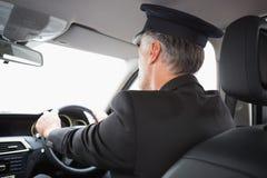 Knappe chauffeur Stock Foto's
