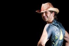 Knappe cowboy met terug geïsoleerdeo lichaamskunst Royalty-vrije Stock Afbeeldingen