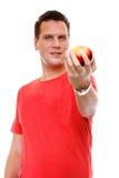 Knappe geïsoleerde mens in rood overhemd met appel Stock Afbeelding