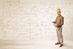 Knappe ingenieur die met hand getrokken achtergrond berekenen Royalty-vrije Stock Afbeeldingen