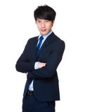Knappe jonge Aziatische mens die dragend een kostuum bevinden zich Royalty-vrije Stock Foto