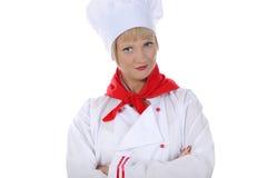 Knappe jonge chef-kok in eenvormig. Royalty-vrije Stock Afbeelding
