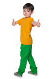 Knappe jonge jongen met zijn omhoog duimen Stock Fotografie