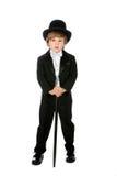 Knappe jonge jongen in zwarte smoking en tophat Royalty-vrije Stock Foto's