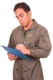 Knappe jonge mannelijke proef het dragen groene eenvormig Stock Foto