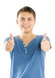 Knappe jonge mens met omhoog duimen Stock Afbeeldingen