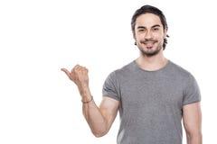 Knappe jonge mens op witte achtergrond stock foto's