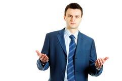 Knappe jonge zakenman die iets verklaart stock fotografie