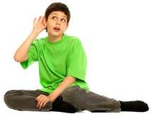 Knappe jongen die meer probeert te horen Royalty-vrije Stock Foto